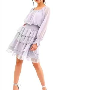 True Decadence tiered dress with ruffle and lace.